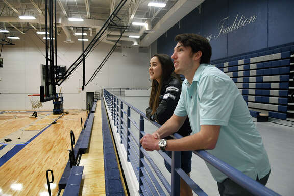 Kingwood High School seniors Ingrid Pina, 17, left, KHS Senior Class President, and Grant Taylor check out the ongoming renovations in the main gym at the school during media interviews and tours held to publicize the March 19 school reopening on March 9, 2018. (Photo by Jerry Baker/Freelance)