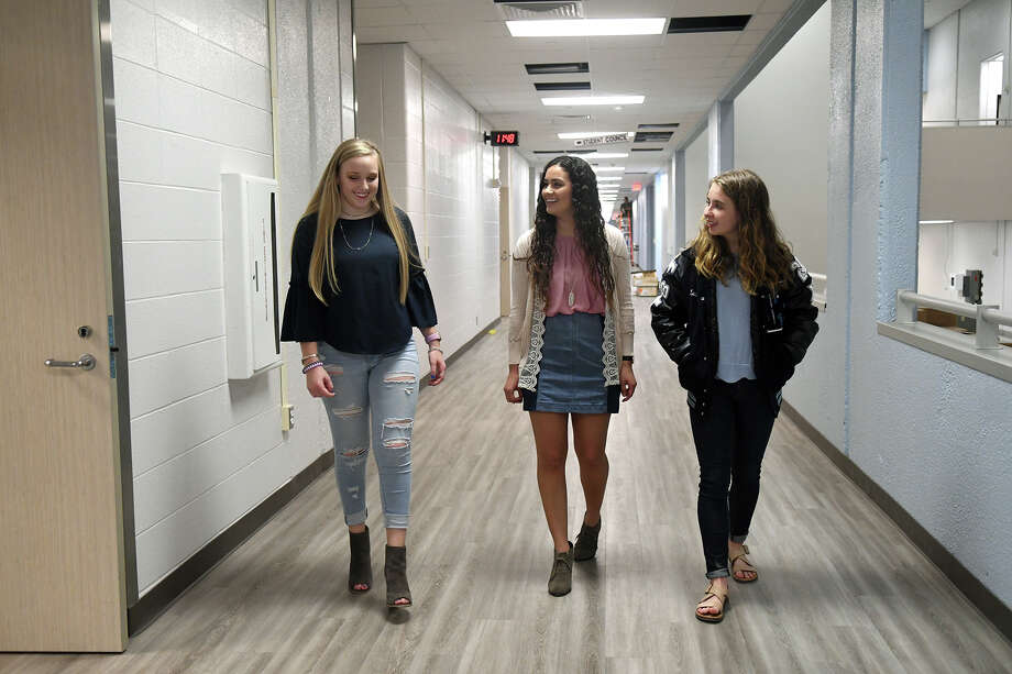 Kingwood High School juniors Abigail McCollum, 16, from left, and Co-KHS 2018-2019 Student Body Presidents Marissa Amar, 17, and Leah Sanders, 16, check out one of the refinished hallways at the school during media interviews and tours held to publicize the March 19 school reopening held on March 9, 2018. (Photo by Jerry Baker/Freelance) Photo: Jerry Baker, Freelance / Freelance