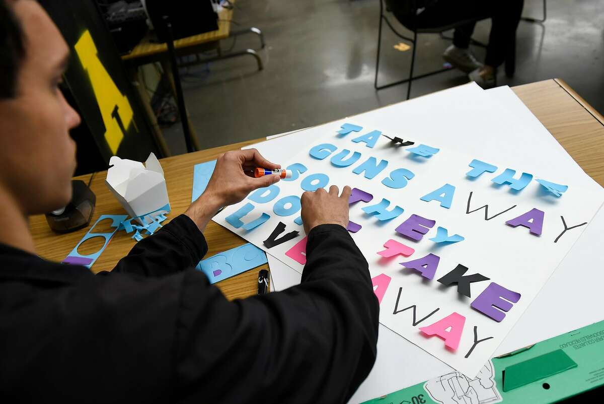 """Student Michael Williams works on his protest poster during a """"Dream Team"""" Class at The Academy SF in San Francisco, Calif., on Friday March 9, 2018."""