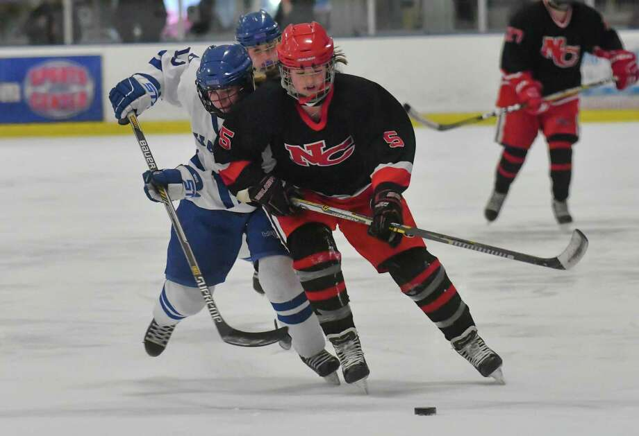 Anika Curri (5) of the New Canaan Rams brings the puck up ice during the state semi-final game against the Darien Blue Wave at the Shelton Rinks on Friday March 9, 2018, in Shelton, Connecticut. Photo: Gregory Vasil / For Hearst Connecticut Media / Connecticut Post Freelance