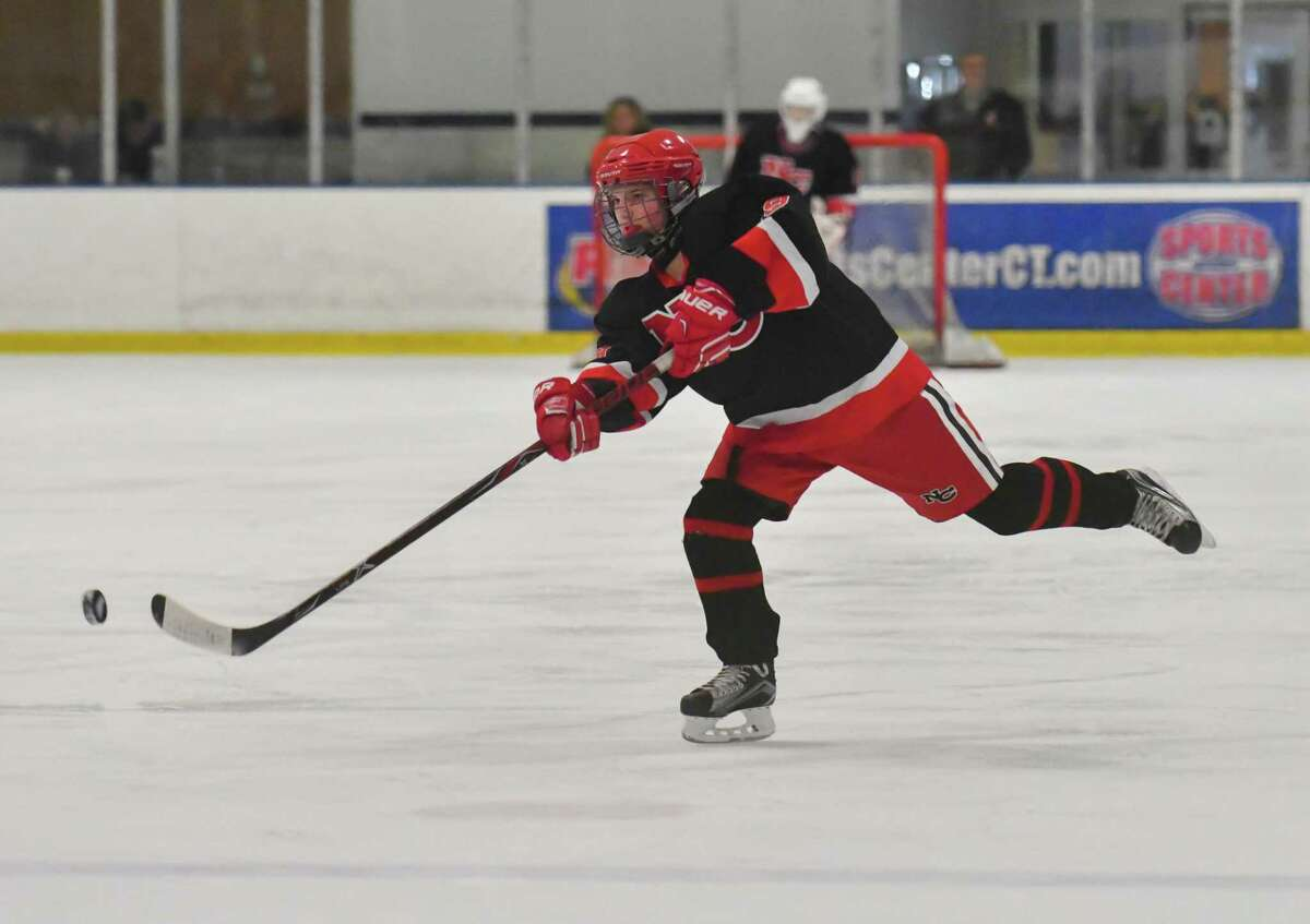 McKenna Harden (19) of the New Canaan Rams shoots during the state semi-final game against the Darien Blue Wave at the Shelton Rinks on Friday March 9, 2018, in Shelton, Connecticut.