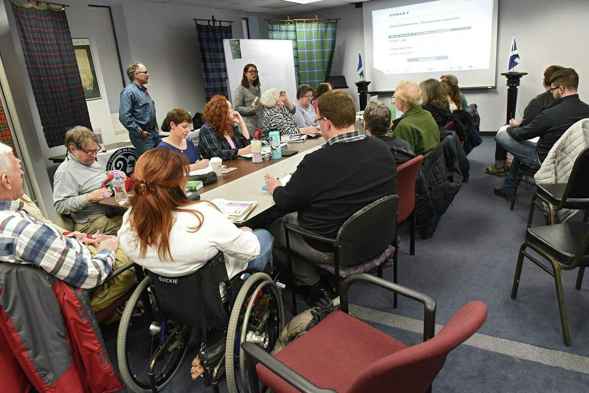 Rodney Aldrich, whose Irish name is Ruairi Aldrich, left, and Georgine Meagher, whose Irish name is Seoirsin Ni Mheachair, teach an Irish Gaelic Language class at the Celtic Hall on Thursday, March 8, 2018 in Colonie, N.Y. The program is certified by the Irish government. (Lori Van Buren/Times Union)