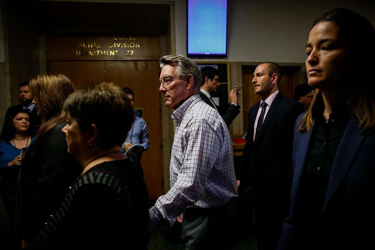 Jim Steinle (checked shirt, center), Kate Steinle's father and Liz Sullivan (black shirt,left), Kate Steinle's mother make their way through the Hall of Justice on the day of closing arguments in the Kate Steinle trial in San Francisco, Calif., on Monday, Nov. 20, 2017.
