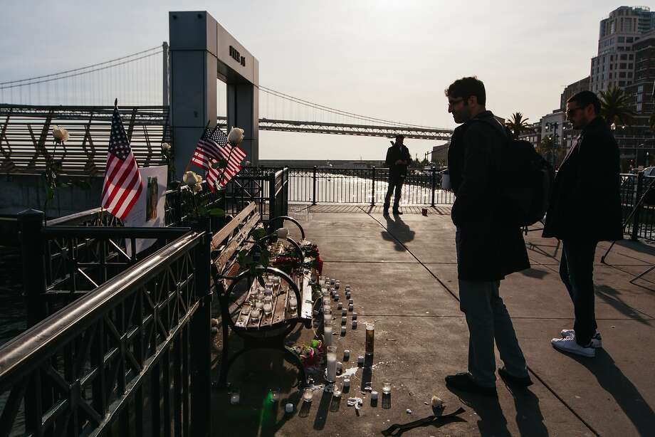 "Passersby on Pier 14 in San Francisco on December 1, 2017, following the acquittal of Garcia Zarate for the murder of Kate Steinle on July 15, 2015. A memorial was erected the previous evening by a group identifying itself as the ""Bay Area Alt Right."" Photo: Peter Prato / Special To The Chronicle"