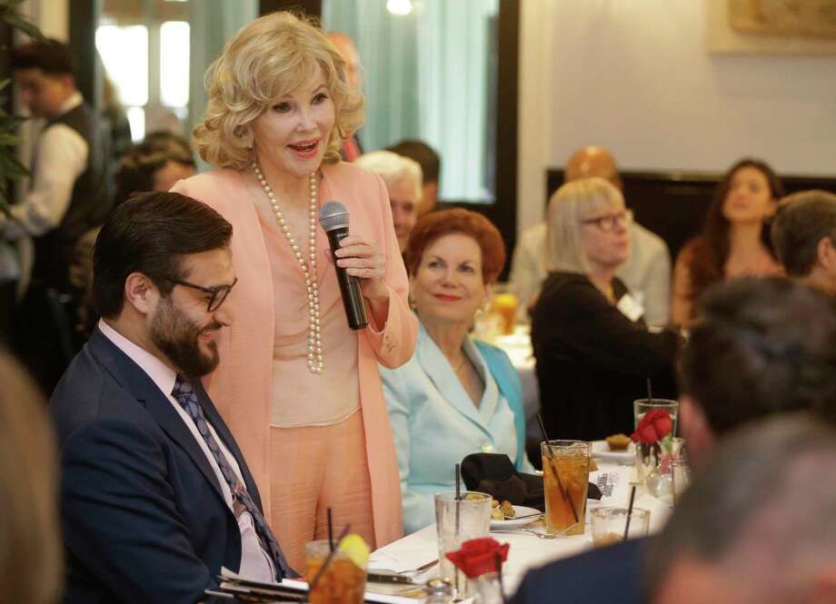 Houston socialite Joanne King Herring, right, shown with the Afghan ambassador to the United States, Hamdullah Mohib, left, speaks during an award luncheon at Ouisie's Table, 3939 San Felipe, Friday, March 9, 2018, in Houston. The ambassador also spoke at the event sponsored by Sister Cities of Houston. The ambassador talked about the work done by Joanne King Herring to develop and assist a village in northern Afghanistan and also presented an award to Herring's son, Robin King, who helped produce a film that was instrumental in getting U.S. aid to Afghanistan in its war against the Soviet Union in the 1980s. ( Melissa Phillip / Houston Chronicle ) Photo: Melissa Phillip / Melissa Phillip / Houston Chronicle / © 2018 Houston Chronicle