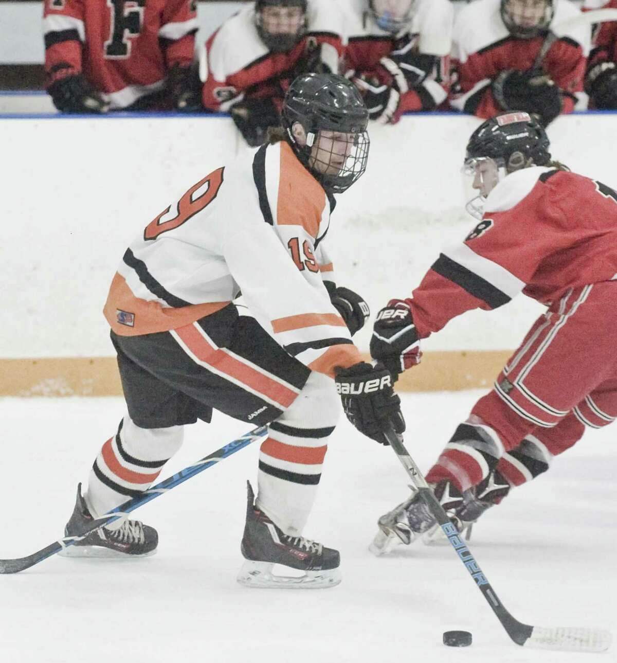 Ridgefield High School's Braeden McSpedon tries to get control of the puck in the first round of the Division-1 game against Fairfield Warde/Ludlowe, played at Ridgefield. Friday, March 9, 2018