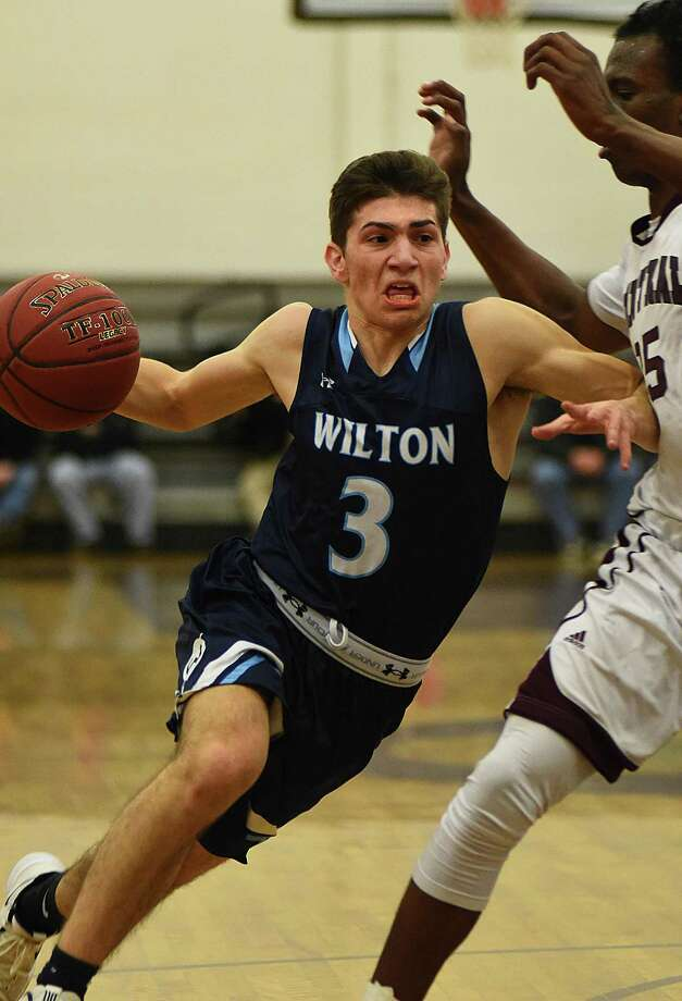 Wilton's Antonio Brancato, left, drives against Bristol Central during Friday's CIAC Division II state tournament game in Bristol. Photo: John Nash / Hearst Connecticut Media