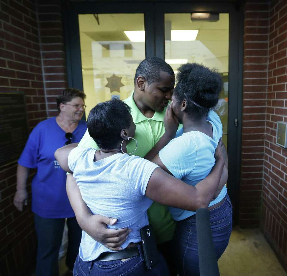 Alfred Brown walks out of the Harris County Jail and into the arms of his sister Connie Brown, left, and daughter Kierra Brown, 15, right on Monday, June 8, 2015, in Houston. ( Karen Warren / Houston Chronicle ) Photo: Karen Warren, Staff / Houston Chronicle / © 2015 Houston Chronicle