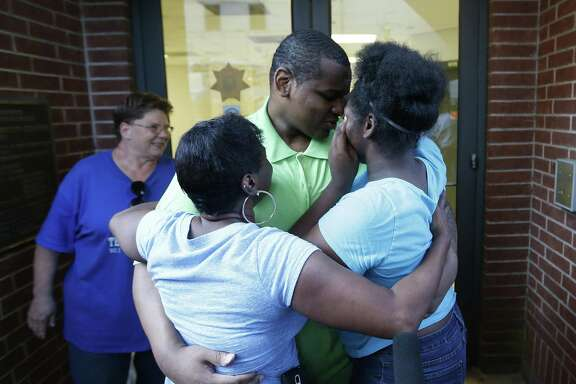 Alfred Brown walks out of the Harris County Jail and into the arms of his sister Connie Brown, left, and daughter Kierra Brown, 15, right on Monday, June 8, 2015, in Houston.