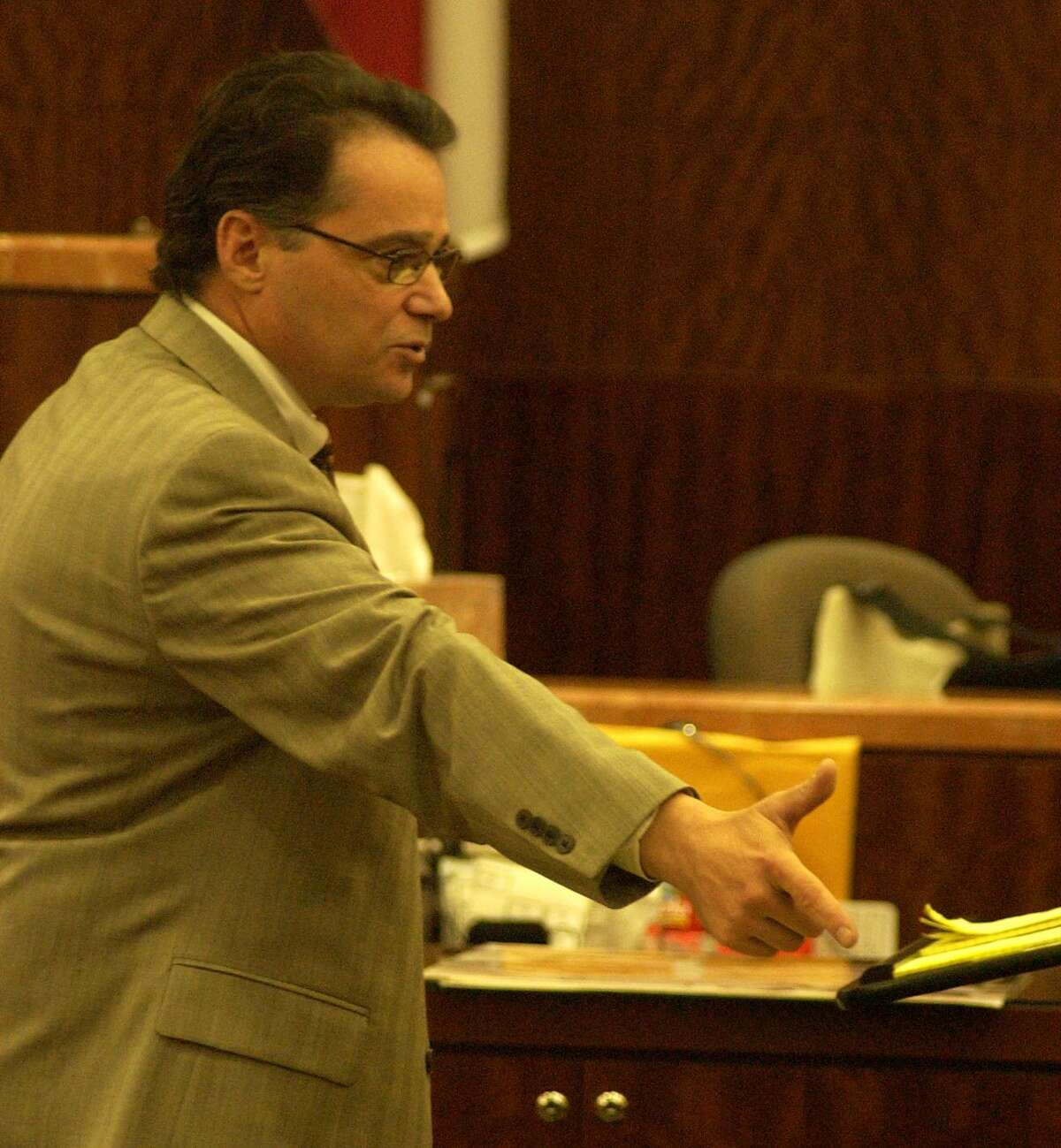 In this 2005 photo, Harris County prosecutor Dan Rizzo gives his closing arguments in the capital murder trial of Alfred Dewayne Brown, the man accused of killing Houston police officer Charles Clark during the robbery of a southeast side check-cashing store in 2003. Photo by Carlos Antonio Rios Houston Chronicle