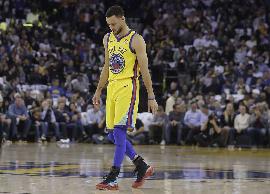 Golden State Warriors guard Stephen Curry (30) walks on the court to shoot free throws during the first half of an NBA basketball game against the San Antonio Spurs in Oakland, Calif., Thursday, March 8, 2018. (AP Photo/Jeff Chiu) Photo: Jeff Chiu, Associated Press