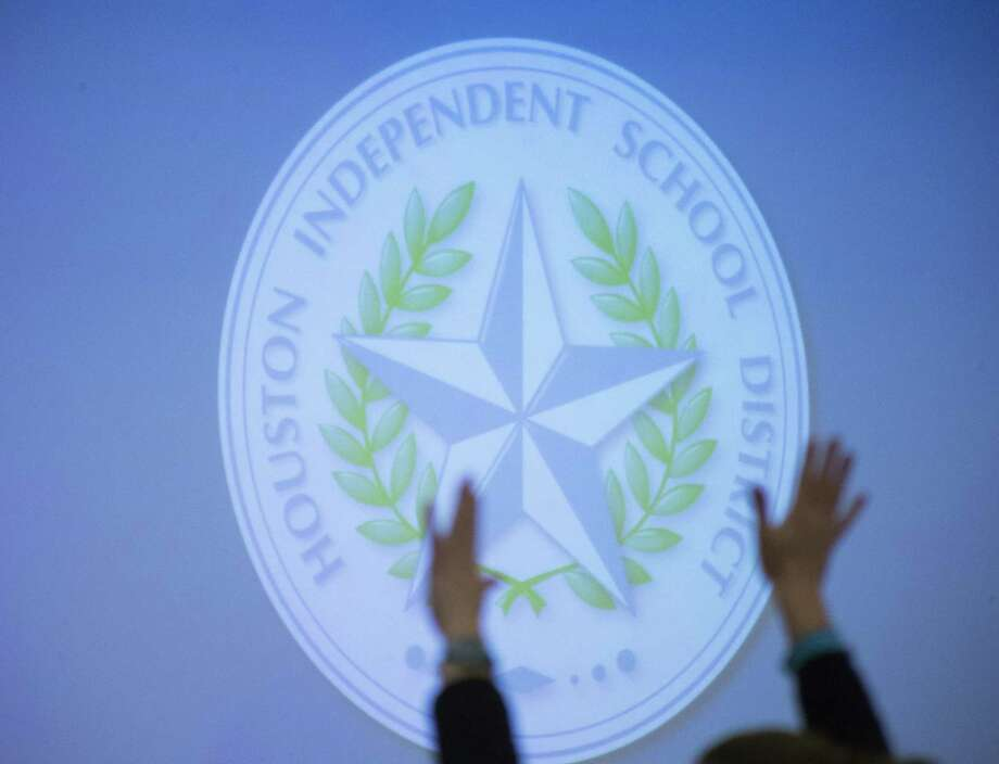 A woman applauds during the public comment portion of a Houston Independent School District school board meeting in Houston on March 8, 2018. Photo: Mark Mulligan, Houston Chronicle / Houston Chronicle / © 2018 Houston Chronicle