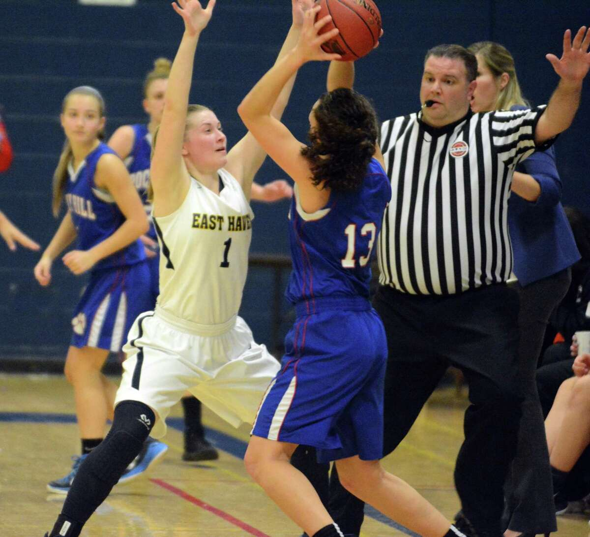 East Haven's Kylie Schlottman, left, defends as Rocky Hill's Grace Moore looks to pass on Friday.