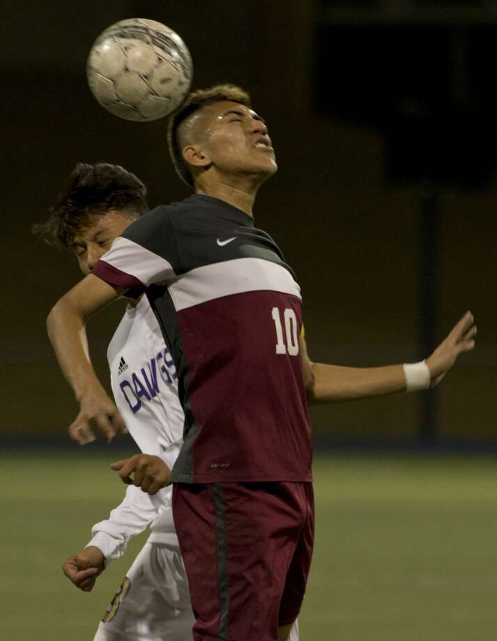 Lee High's Luis Aranda gets his head on the ball over Midland High's Jorge Mitre 03/09/18 at Grande Communications Stadium. Tim Fischer/Reporter-Telegram Photo: Tim Fischer/Midland Reporter-Telegram