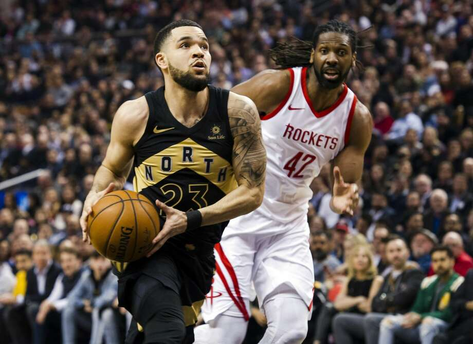 Toronto Raptors guard Fred VanVleet (23) drives to the net past Houston Rockets center Nene Hilario (42) during the first half of an NBA basketball game in Toronto, Friday, March 9, 2018. (Christopher Katsarov/The Canadian Press via AP) Photo: Christopher Katsarov/Associated Press