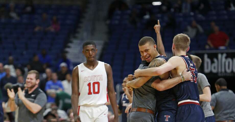 Tompkins celebrates after defeating South Garland in Friday's Class 6A boys basketball UIL state semifinal between South Garland (area team) and Katy Tompkins on Friday, March 9, 2018 at the Alamodome.  (Ronald Cortes/Special Contributor) Photo: Ronald Cortes
