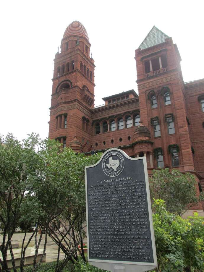 A Texas State Historical Survey Committee marker in front of the Bexar County Courthouse recognizes the Canary Islanders as the earliest civilian colonists of San Antonio, who formed the first organized civil government in Texas, in addition to founding the Village of San Fernando de Bexar in 1731. Photo: Terry Scott Bertling / San Antonio Express-News
