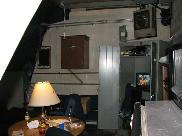 "An interior photograph of the so-called ""man cave"" where a state janitor and his boss built a secret lounge at garage near the Empire State Plaza  that they allegedly used to sell drugs, smoke pot and sleep during work hours, according to the state Inspector General. ( New York State Police photo )"