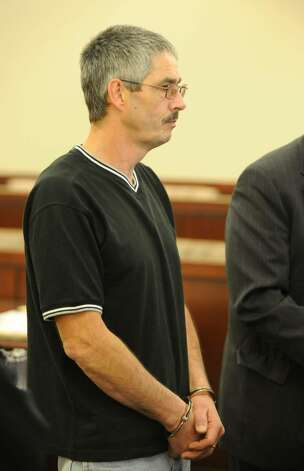 "Gary Pivoda, 48, of Latham, one of two state workers who allegedly turned their downtown Albany maintenance garage into a pot-friendly ""man cave,"" appears before Judge Stephen Herrick in the Albany Judicial Center in Albany on Oct. 22, 2009.   (Skip Dickstein / Times Union) Photo: Skip Dickstein / 2008"