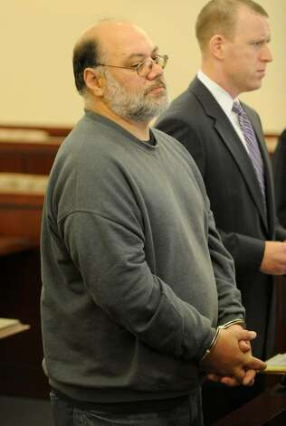 "Louis Marciano, 50, of Rensselaer, one of two state workers who allegedly turned their downtown Albany maintenance garage into a pot-friendly ""man cave""  based on secret video footage captured by state investigators, appears in front of Judge Stephen Herrick in the Albany Judicial Center in Albany on Oct. 22, 2009.   (Skip Dickstein / Times Union) Photo: Skip Dickstein / 2008"
