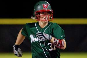 Abbey Newlun #31 of The Woodlands heads to third after hitting a triple during the second inning of a District 12-6A high school softball game, Friday, March 9, 2018.