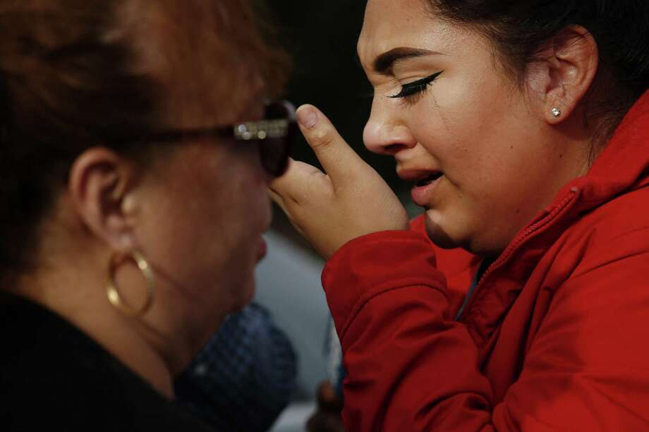 Hirma Vanessa Flores (in red), a 22-year-old caregiver who was working inside the Veterans Home of California during an ongoing hostage situation, gets emotional outside the home, Friday, March 9, 2018, in Yountville, Calif. Photo: Santiago Mejia, Staff / The Chronicle / ONLINE_YES