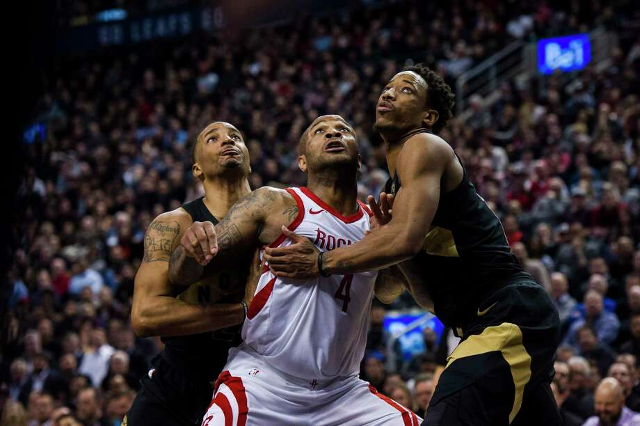 Rockets forward P.J. Tucker, center, Raptors forward/guard Norman Powell, left, and Raptors guard DeMar DeRozan jockey for position in the lane for a rebound in the second half, when each possession was important. Tucker had six boards. Photo: Christopher Katsarov, SUB / CKL