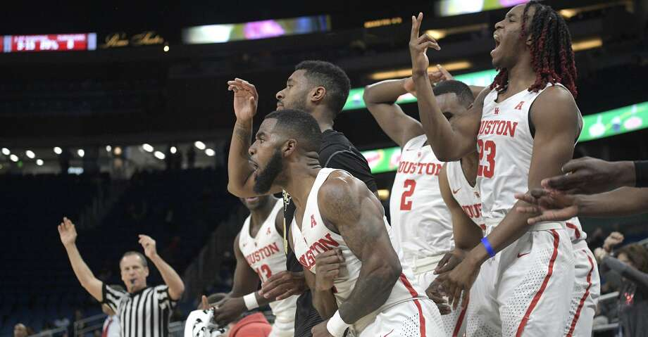 Houston guard Corey Davis Jr. (5), front, celebrates after hitting a 3-pointer in front of Central Florida guard Ceasar DeJesus (4) during the second half of an NCAA college basketball quarterfinal game at the American Athletic Conference tournament Friday, March 9, 2018, in Orlando, Fla. Houston won 84-56. (AP Photo/Phelan M. Ebenhack) Photo: Phelan M. Ebenhack/Associated Press