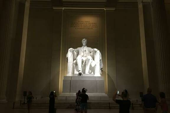 Tourists visit the Lincoln Memorial in Washington, D.C., an example of how well-kempt the city is.