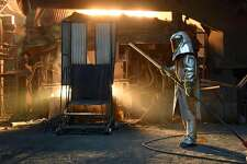 """A steelworker in a protective suit checks the temperature of molten metal in furnace at the TMK Ipsco Koppel plant in Koppel, Pennsylvania on March 9, 2018. Several US lawmakers, industry leaders and foreign governments have decried US President Donald Trump's announced tariffs on steel and aluminum imports. But the reaction was far different in Steel City. The workers and companies in and around Pittsburgh, the industrial engine of western Pennsylvania that used to produce much of the world's steel, have aligned with the president, saying his announcement is less of a protectionist measure than a levelling of the playing field for American workers. / AFP PHOTO / Michael Mathes / TO GO WITH AFP STORY by Michael Mathes, """"In steel country, a thumbs up to Trump's tariffs""""MICHAEL MATHES/AFP/Getty Images"""