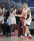Houston guard Rob Gray (32) reacts after a score during the first half of an NCAA college basketball game against Central Florida in the quarterfinals of the American Athletic Conference tournament, Friday, March 9, 2018, in Orlando, Fla. (AP Photo/Phelan M. Ebenhack)