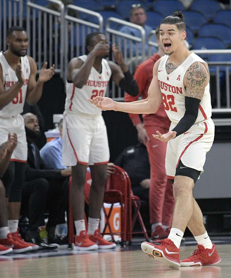 Houston guard Rob Gray (32) reacts after a score during the first half of an NCAA college basketball game against Central Florida in the quarterfinals of the American Athletic Conference tournament, Friday, March 9, 2018, in Orlando, Fla. (AP Photo/Phelan M. Ebenhack) Photo: Phelan M. Ebenhack/Associated Press