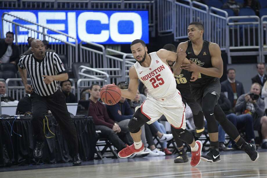 Houston guard Galen Robinson Jr. (25) is fouled by Central Florida guard B.J. Taylor (1) after stealing the ball during the second half of an NCAA college basketball quarterfinal game at the American Athletic Conference tournament Friday, March 9, 2018, in Orlando, Fla. Houston won 84-56. (AP Photo/Phelan M. Ebenhack) Photo: Phelan M. Ebenhack/Associated Press
