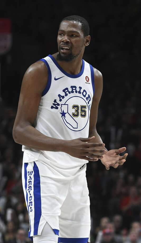 fead94aad9c Golden State Warriors forward Kevin Durant reacts to being called for a foul  late in the