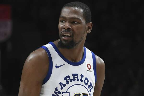 Golden State Warriors forward Kevin Durant reacts to being called for a foul late in the second half of the team's NBA basketball game against the Portland Trail Blazers in Portland, Ore., Friday, March 9, 2018. The Blazers won 125-108.(AP Photo/Steve Dykes)