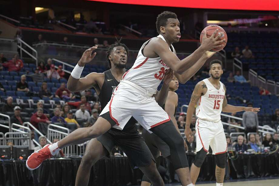 PHOTOS: Fertitta Center  Houston forward Fabian White Jr. (35) grabs a rebound in front of Central Florida forward Chad Brown (21) during the second half of an NCAA college basketball quarterfinal game at the American Athletic Conference tournament Friday, March 9, 2018, in Orlando, Fla. Houston won 84-56. (AP Photo/Phelan M. Ebenhack) >>>Browse through the gallary for a look at the Fertitta Center, which is scheduled to open Dec. 1 during a game between the University of Houston and Oregon ... Photo: Phelan M. Ebenhack/Associated Press