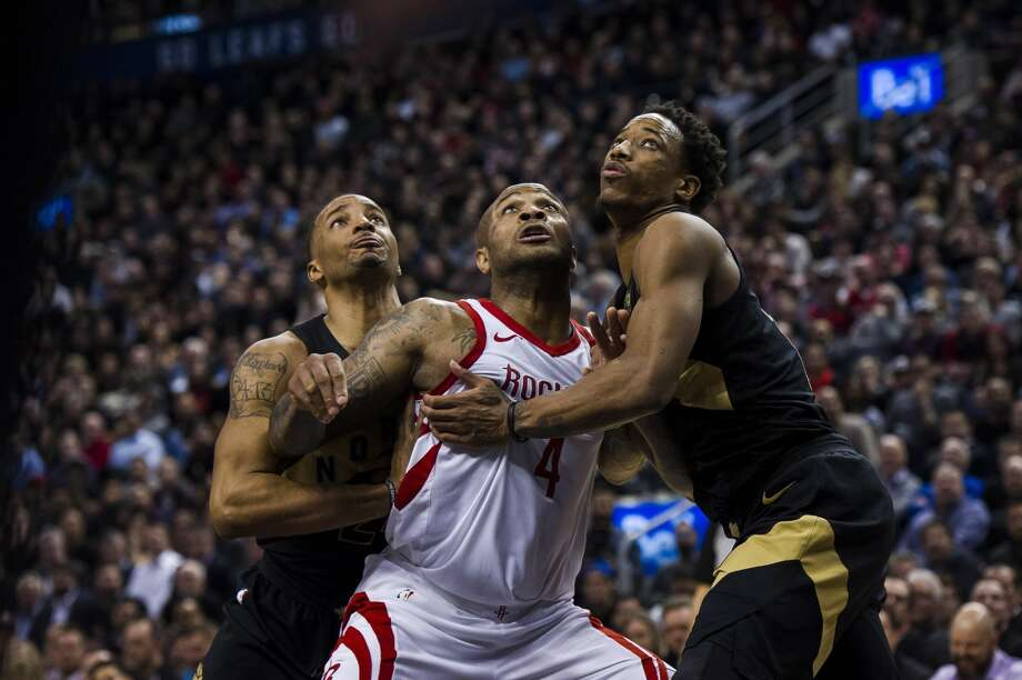 Houston Rockets forward PJ Tucker (4), Toronto Raptors guard DeMar DeRozan (10) and Toronto Raptors guard Fred VanVleet (23) battle for position on a rebound during the second half of an NBA basketball game in Toronto, Friday, March 9, 2018. (Christopher Katsarov/The Canadian Press via AP) Photo: Christopher Katsarov/Associated Press