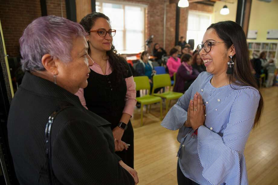 Sarahi Espinoza Salamanca, creator of Dreamers Road Map chats with Olga Telamante, Executive Dir. at Chicuha Latina Foundation and Paula Linares Cruz Consul for Cultural Affairs at the Mexican Consulate in San Francisco, California, USA 8 Mar 2018. Photo: Peter DaSilva, Special To The Chronicle