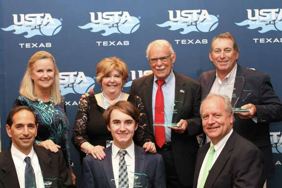 USTA Texas honored several local volunteer contributors at its annual awards banquet in February. Pictured are (back row, from left) Dayna Erck, Houston Tennis Association Executive Director Cheryl Hultquist, Tony DeSantis, Peter Farrell. (front row) Sammy Giammalva, Jr., Peyton Erck and Ted Erck.