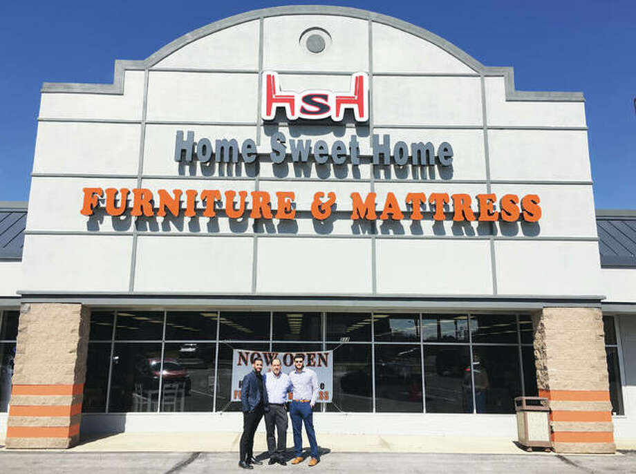 Home Sweet Home Furniture & Mattresses Signature Design by Ashley, 512 W. Delmar Ave., Alton, utilizes 17,000-square-feet of Piasa Center strip mall's retail space, which is 60,000 square feet. The owner's family friend, Abdul Alqam, left, Sam Ramadan, center, and Ramadan's son, Tommy Ramadan, who owns and operates Home Sweet Home Furniture & Mattresses, celebrates the store's grand opening, which included a ribbon cutting hosted by the RiverBend Growth Association, last Thursday. Photo: Jill Moon|The Telegraph