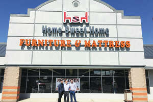Home Sweet Home Furniture & Mattresses Signature Design by Ashley, 512 W. Delmar Ave., Alton, utilizes 17,000-square-feet of Piasa Center strip mall's retail space, which is 60,000 square feet. The owner's family friend, Abdul Alqam, left, Sam Ramadan, center, and Ramadan's son, Tommy Ramadan, who owns and operates Home Sweet Home Furniture & Mattresses, celebrates the store's grand opening, which included a ribbon cutting hosted by the RiverBend Growth Association, last Thursday.