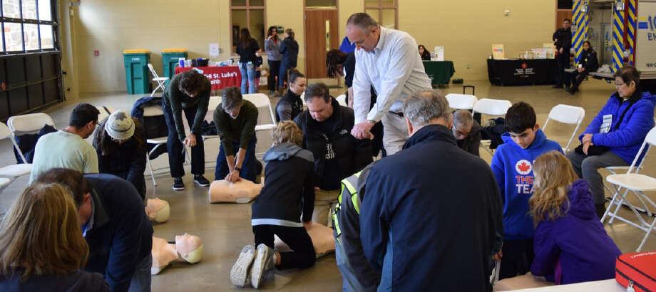 Volunteer and CPR advocate Ron Mullins presents the Hands Only method of CPR to a group of residents. Photo: Courtesy Photo