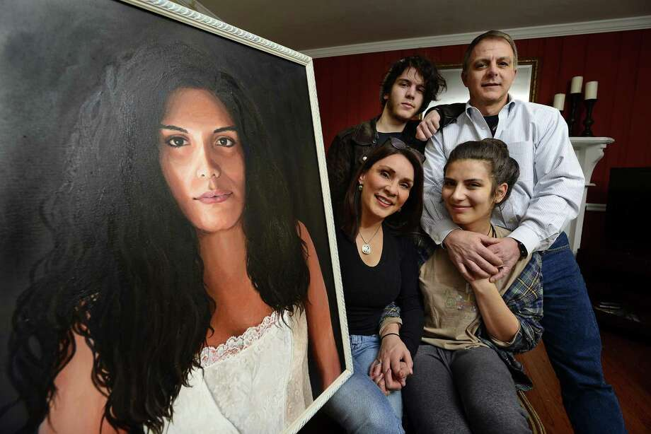 The Tarzia family, Janet, Christian, Nick and Jessie Tarzia, 18, who is transgender, are photographed on Tuesday, March 6, 2018 in Stamford, Connecticut with a painting of Jessie. Photo: Matthew Brown / Hearst Connecticut Media / Stamford Advocate