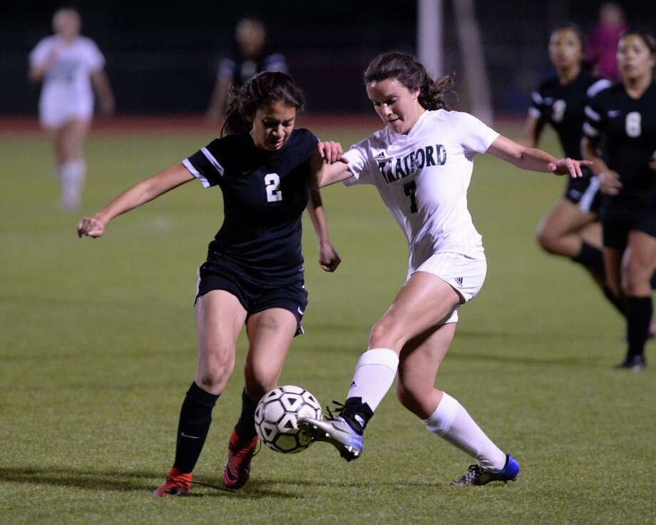Norma Garcia (2) of Spring Woods and Victoria Nacinovich (7) of Stratford compete for a ball during the second half of a varsity soccer game between the Stratford Spartans and the Spring Woods Tigers on Friday, March 9, 2018 at Stratford HS, Houston, TX. Photo: Craig Moseley, Staff / ©2018 Houston Chronicle