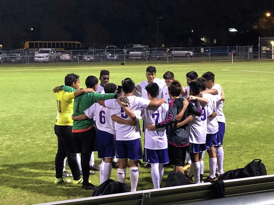 The Humble soccer team huddles before their game against Dayton at Charles Street Stadium on March 6 Photo: Elliott Lapin