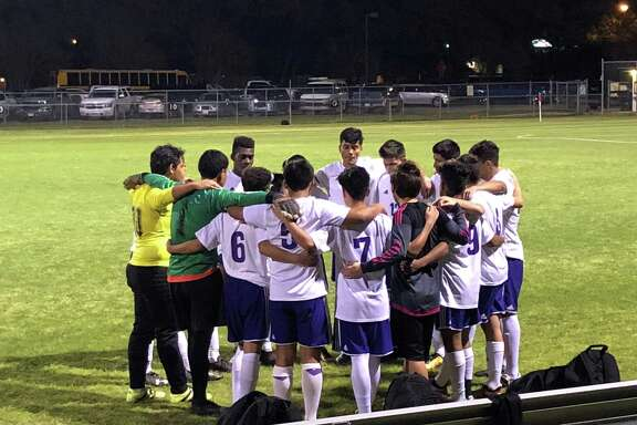 The Humble soccer team huddles before their game against Dayton at Charles Street Stadium on March 6
