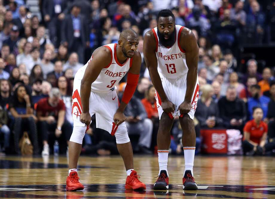 TORONTO, ON - MARCH 9:  James Harden #13 of the Houston Rockets speaks with teammate Chris Paul #3 during the first half of an NBA game against the Tronto Raptors at Air Canada Centre on March 9, 2018 in Toronto, Canada. (Photo by Vaughn Ridley/Getty Images) Photo: Vaughn Ridley/Getty Images