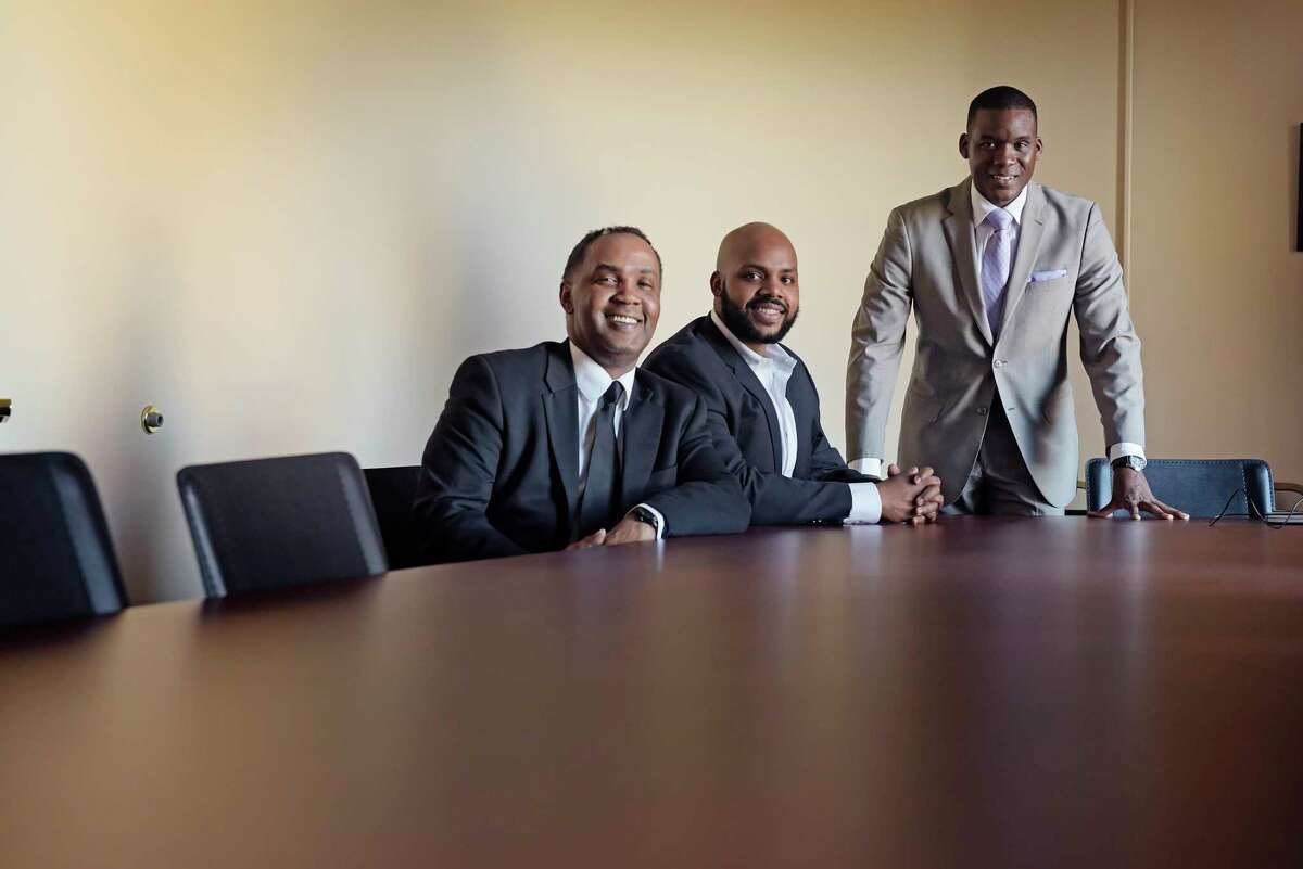 Tony Gaddy, left, Jahkeen Hoke, center, and Corey Ellis pose for a photo in the office's of the Capital District Black Chamber of Commerce on Tuesday, March 6, 2018, in Albany, N.Y. (Paul Buckowski/Times Union)