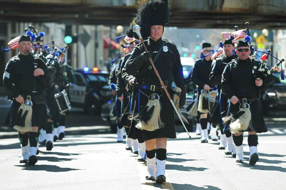 Parade participants including the Fairfield County Police Pipes and Drums march down North Main Street during the third annual Norwalk St. Patricks Day Parade Saturday, March 10, 2018, in Norwalk, Conn. The parade also featured the music of the Greenwich Pipe Band, along with members of the Norwalk Police Emerald Society, Norwalk Police Department, Norwalk Fire Department, Rowayton Fire Department, Norwalk Hospital Emergency Medical Service, Norwalk veterans, ONeills Irish Pub float, Irish Step Dancers, and the Pyramid Shriners Klowns. Photo: Erik Trautmann / Hearst Connecticut Media / Norwalk Hour