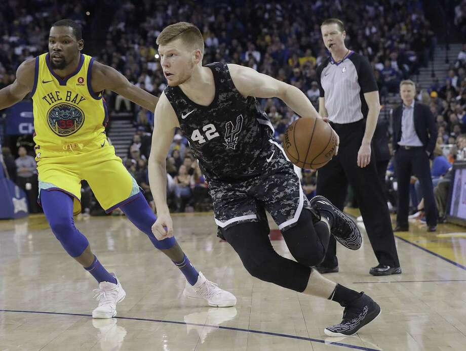 San Antonio Spurs forward Davis Bertans dribbles in front of Golden State Warriors forward Kevin Durant during the second half of an NBA basketball game in Oakland, Calif., Thursday, March 8, 2018. Citing an anonymous source, Sportando reported Monday morning that Bertans is set to sign a four-year, $20 million deal with the Spurs. Photo: Jeff Chiu, STF / Associated Press / Copyright 2018 The Associated Press. All rights reserved.